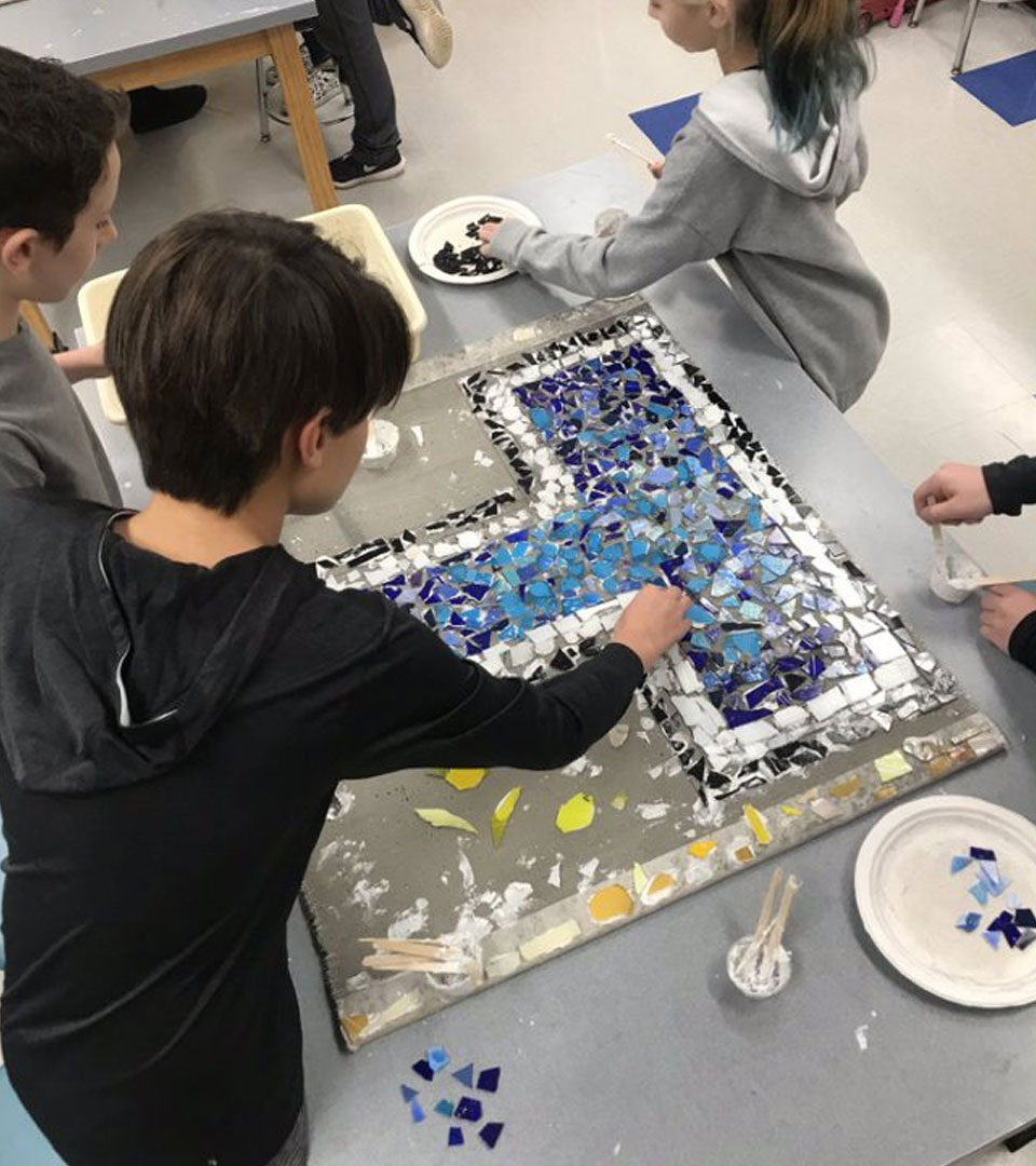 Trinity Area School District students working on a glass mosaic with PGC instructors
