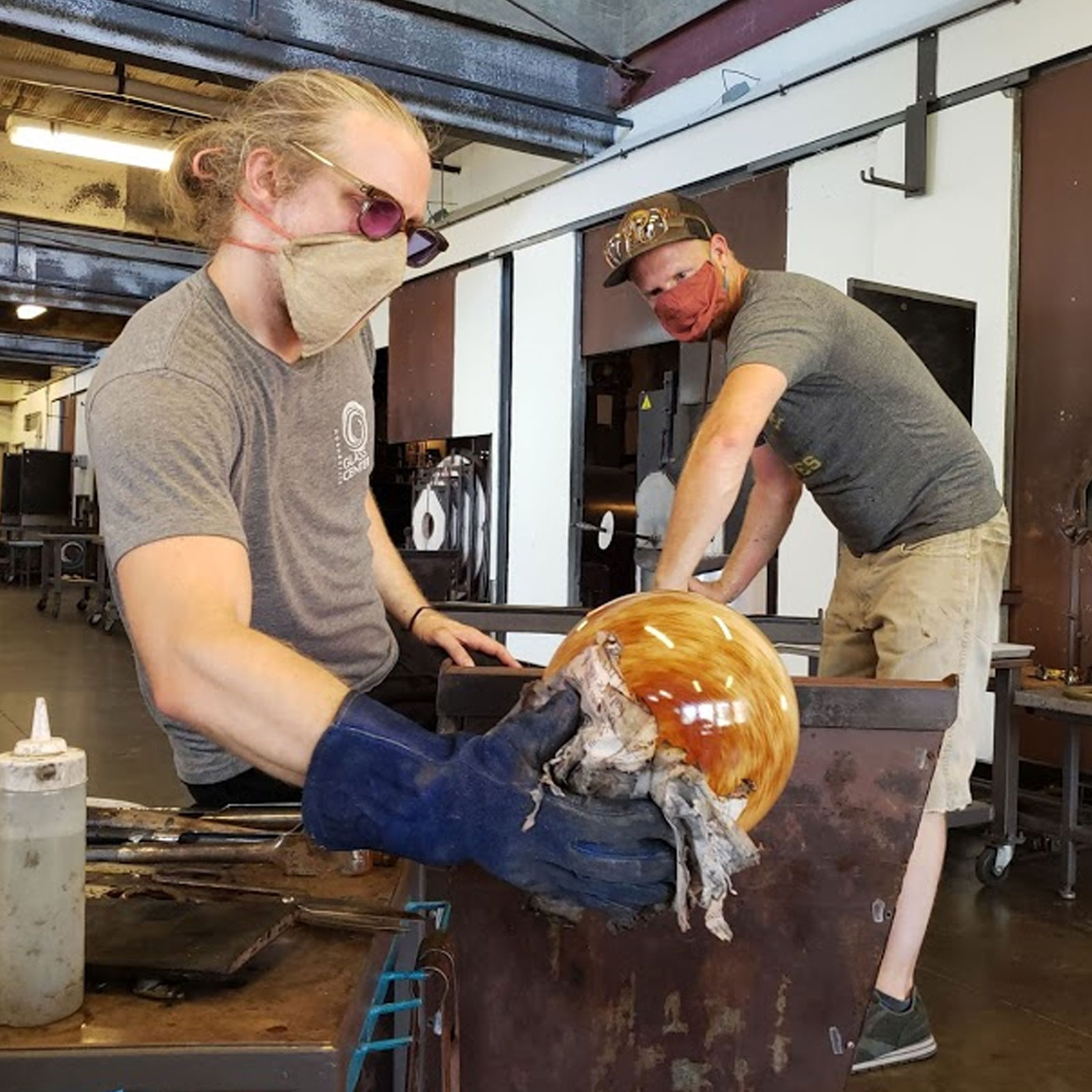 Glassblowers working with masks