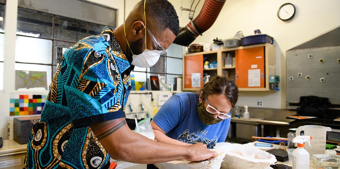 Mikael Owunna making a mold