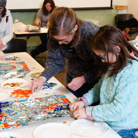 Families creating glass mosaic art at Pittsburgh Glass Center